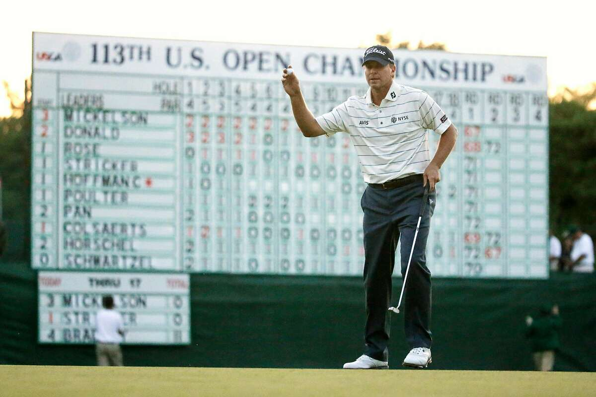 Steve Stricker reacts after putting on the 18th green during the second round of the U.S. Open golf tournament at Merion Golf Club, Friday, June 14, 2013, in Ardmore, Pa. (AP Photo/Morry Gash)