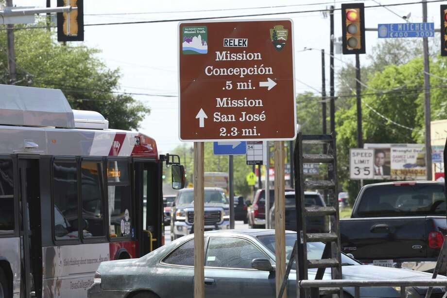 A guidepost leads visitors to the missions through Roosevelt Avenue. On Tuesday, the Zoning Commission voted 5-3 in favor of a city proposal to downzone businesses it believes are hampering economic development near the mission World Heritage sites. But a zoning change requires six votes to win approval, so the commission is technically making a recommendation of denial to City Council, which is set to consider the proposal it in August. Photo: Jerry Lara /San Antonio Express-News / San Antonio Express-News