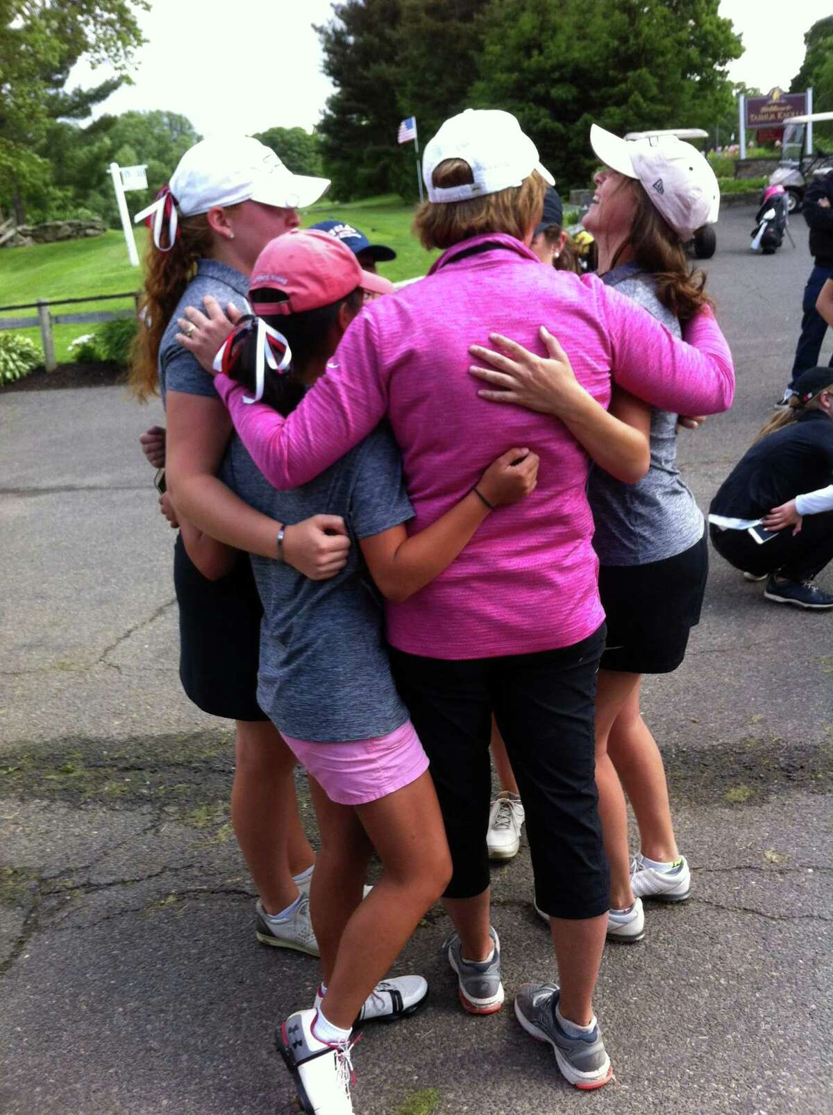 New Canaan celebrates after winning the CIAC girls golf championship on Tuesday, June 5, 2018 at Tashua Knolls Golf Club in Trumbull, Conn.