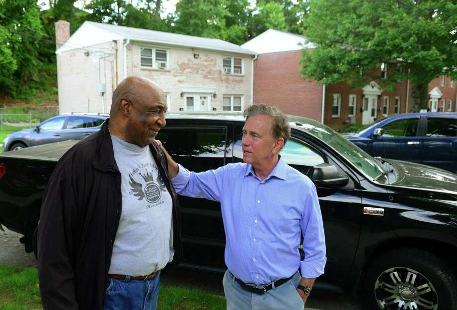 Ned Lamont, right, chats with Willie Murphy, a resident of the Second Stoneridge co-op, during a campaign stop at the co-op on Yaremich Drive in Bridgeport Tuesday. Photo: Christian Abraham / Hearst Connecticut Media / Connecticut Post