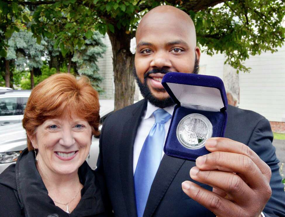 Jahkeen Hoke, right, of 4th Family Inc. poses with Mayor Kathy Sheehan and his Henry Johnson Award for Distinguished Community Service during the 2nd Annual Henry Johnson Day observance Tuesday June 5, 2018 in Albany, NY. (John Carl D'Annibale/Times Union)