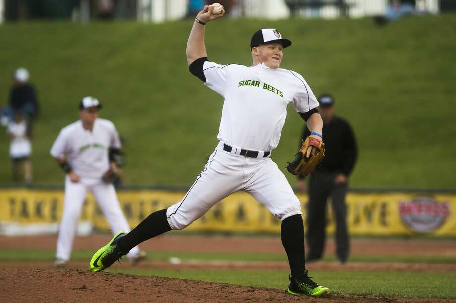 Saginaw Sugar Beets pitcher Billy Blair pitches the ball during the team's inaugural game against the St. Clair Green Giants on Tuesday, June 5, 2018 at Dow Diamond. (Katy Kildee/kkildee@mdn.net) Photo: (Katy Kildee/kkildee@mdn.net)