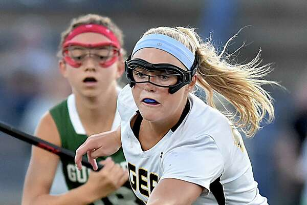 Hand senior Riley Kokoruda wins the ball battling Guilford senior midfielder Olivia Clarke in the CIAC Class M semifinal lacrosse game, Tuesday, June 5, 2018, at Ken Strong Stadium at West Haven High School. Hand will play Branford in the championship round at Jonathan Law High School in Milford, Saturday, June 9, 2018.