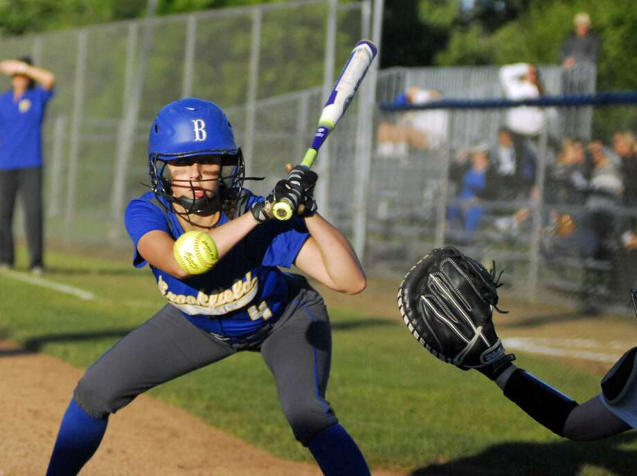 Brookfield's Avery Katz looks at a pitch during a Class L semifinal game against Daniel Hand on Tuesday. Photo: Ryan Lacey /Hearst Connecticut Media