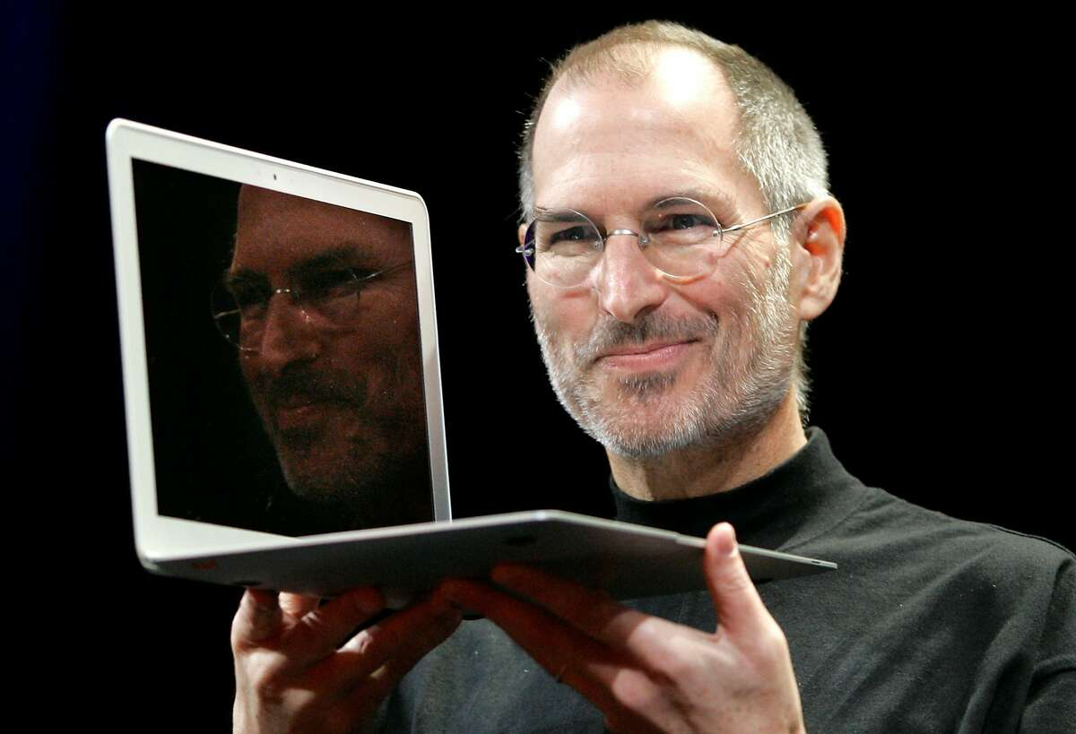 Apple CEO Steve Jobs holds up the original MacBook Air when it was unveiled at the Apple MacWorld Conference in San Francisco, Tuesday, Jan. 15, 2008. (AP Photo/Jeff Chiu)