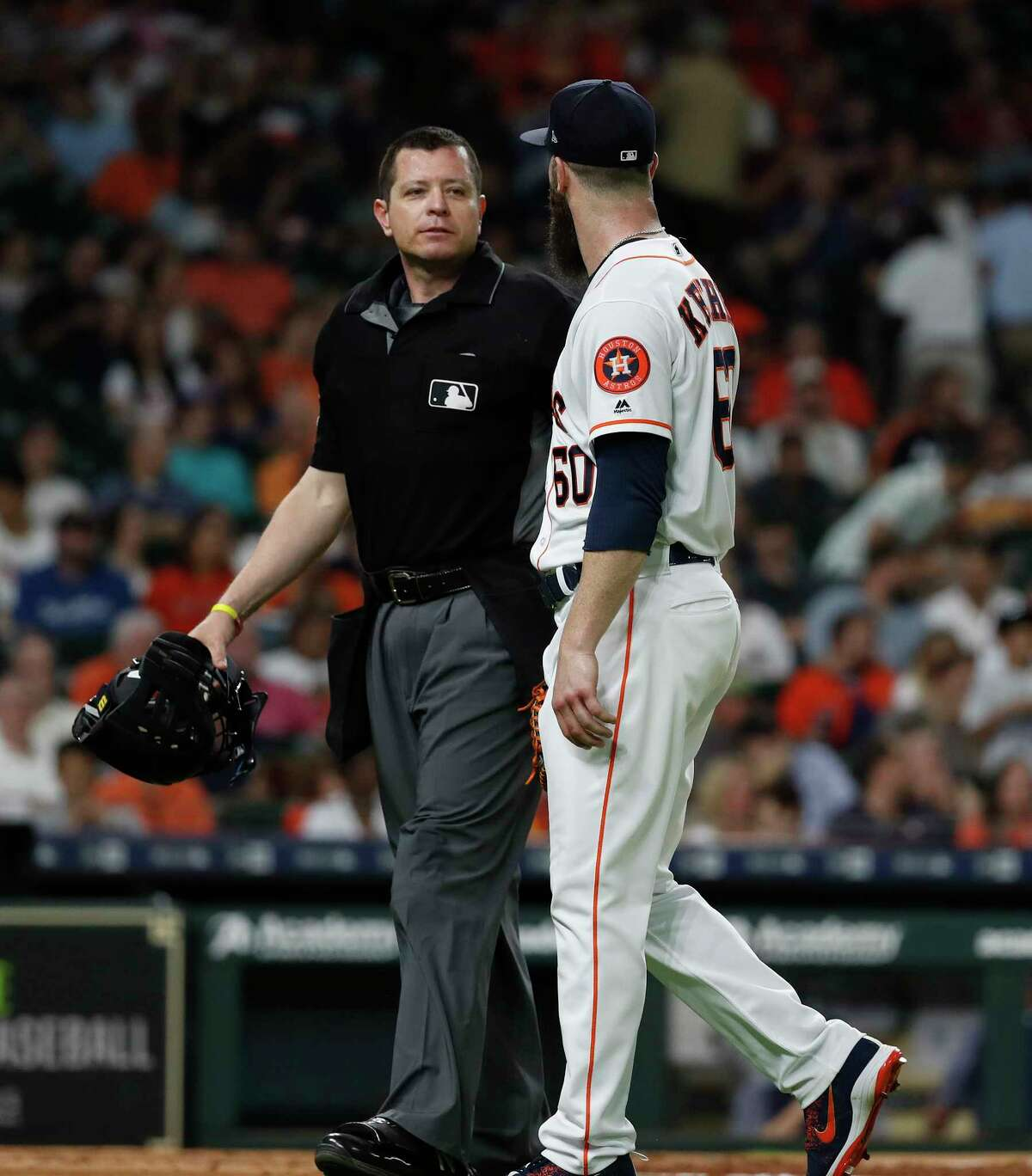 Houston Astros starting pitcher Dallas Keuchel (60) has words with home plate umpire Carlos Torres after getting pulled during the seventh inning of an MLB game at Minute Maid Park, Tuesday, June 5, 2018, in La Porte.