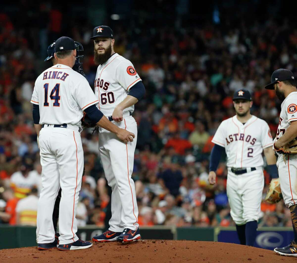 Houston Astros manager AJ Hinch (14) visits the mound to pull starting pitcher Dallas Keuchel (60) during the seventh inning of an MLB game at Minute Maid Park, Tuesday, June 5, 2018, in La Porte.