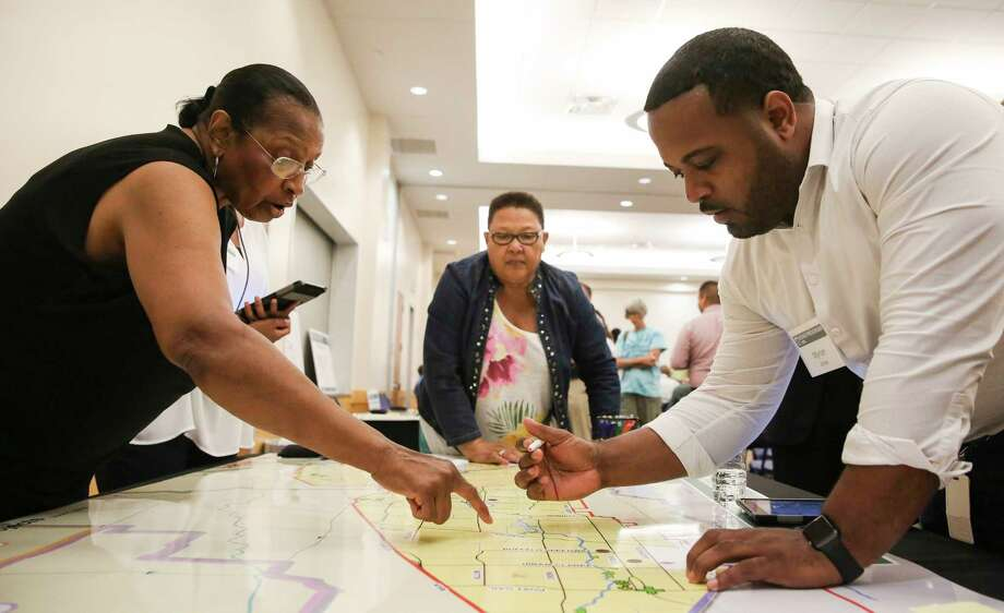 Almeda Plaza residents Bernadine Wilturner, from left, and Mary Booker point out flooded areas during Hurricane Harvey to Harris County Flood Control District staff Myron Jones on a map during the agency's first community meeting on the $2.3 billion flood bond at the Hiram Clarke Multi-Service Center on Tuesday, June 5, 2018, in Houston. Wilturner and Booker came to the meeting to find out what plans does the agency have to prevent her neighborhood from flooding. Photo: Yi-Chin Lee, Houston Chronicle / © 2018 Houston Chronicle