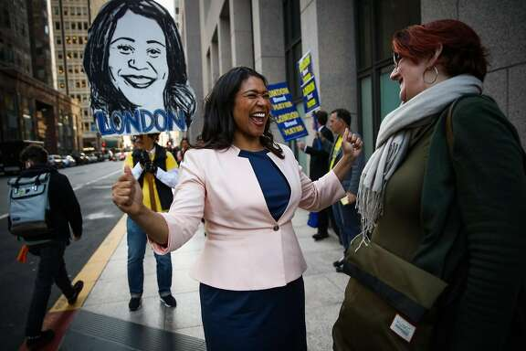 San Francisco mayoral candidate and Board of Supervisors President London Breed (left) chat with Diane Carr (right) while doing a last minute campaign stop downtown in San Francisco, California, on Tuesday, June 5, 2018.