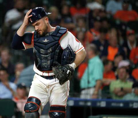 dd082a5cd14d8 Houston Astros catcher Max Stassi (12) puts his helmet back on after  fielding Seattle