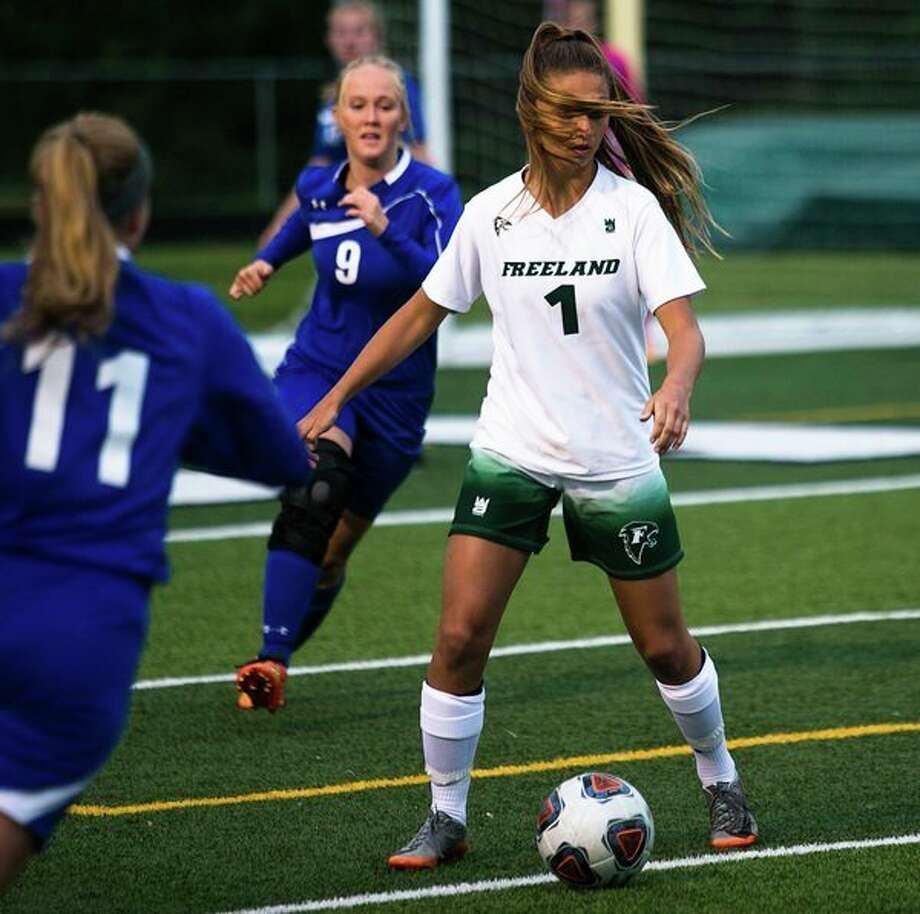 Freeland junior Autumn Kloha dribbles the ball during the Division 3 Girls Regional Semifinal at the Brookwood Athletic Complex in Clare on Tuesday, June 5, 2018. Freeland won, 8-0. (Mackenzie Brockman/for the Daily News)