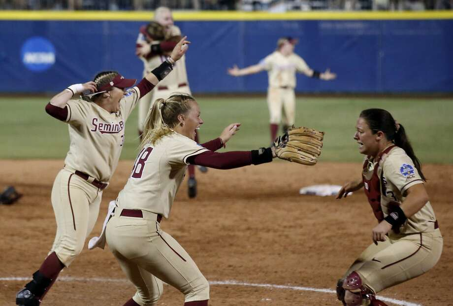 Florida State players get the party started after the final out of their national title-clinching win over Washington. Photo: Sue Ogrocki / Associated Press