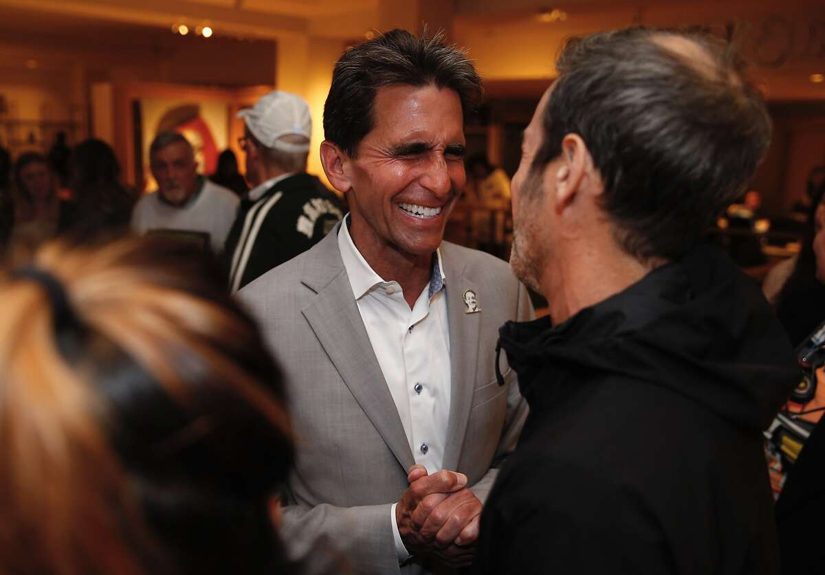 San Francisco mayoral candidate Mark Leno greets supporters at his campaign headquarters during his election night party.