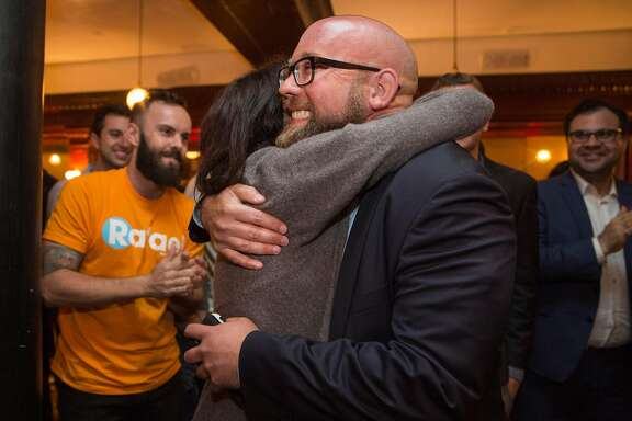 Hillary Ronen, San Francisco Supervisor for District Nine, hugs Rafael Mandelman as he arrives to Cafe du Nord on Tuesday night for Election night gathering. June 5, 2018 in San Francisco Calif. Rafael Mandelman is running to represent District 8 on the San Francisco Board of Supervisors.