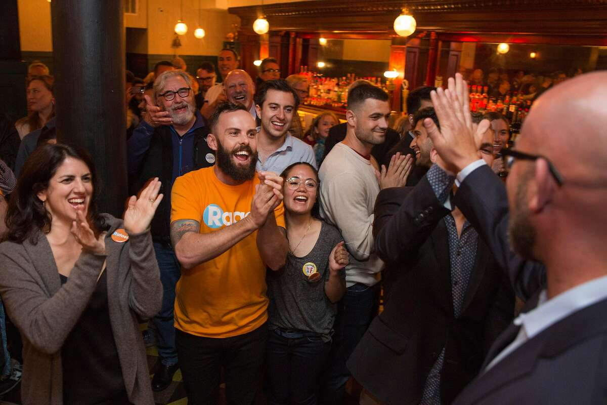 Supports cheer as Rafael Mandelman arrives to Cafe du Nord on Tuesday night, June 5, 2018 in San Francisco Calif. Rafael Mandelman is running to represent District 8 on the San Francisco Board of Supervisors.