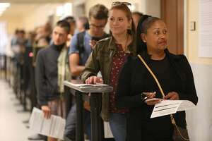 Voters Michelle Brewster (front) and Makenna Martinez (behind) wait in line to get their ballots drop off their ballots atf city hall on Tuesday, June 5, 2018 in San Francisco, Calif.