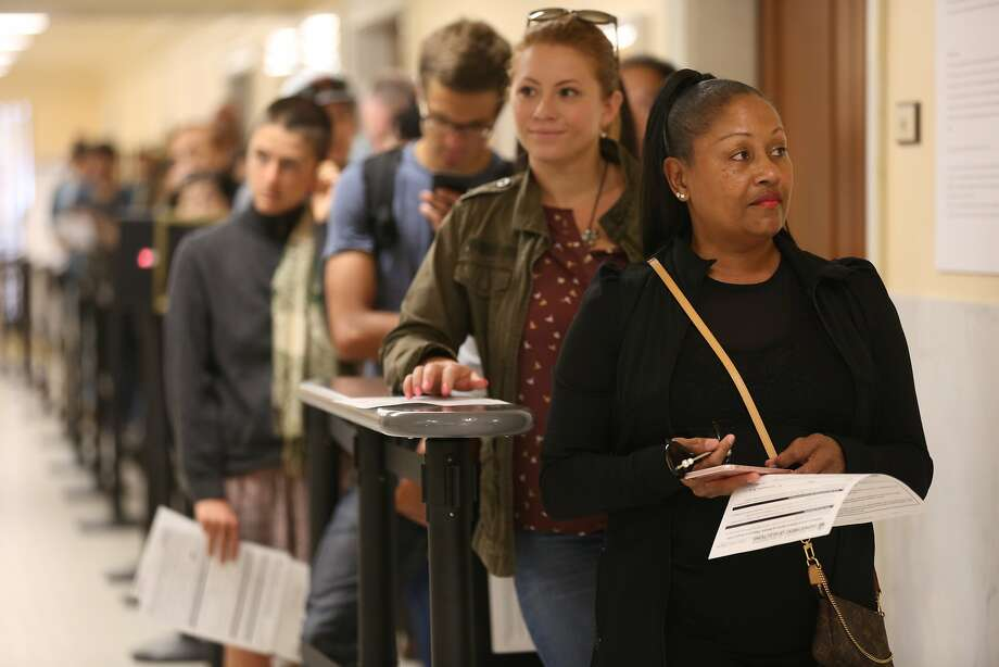 Voters Michelle Brewster (front) and Makenna Martinez (behind) wait in line to drop off their ballots at city hall on June 5, 2018 in San Francisco. Photo: Liz Hafalia, The Chronicle