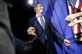 Gavin Newsom takes the stage and speaks to his supporters during his election night party at Verso, Tuesday, June 5, 2018, in San Francisco, Calif. Newsom is running for Governor of California.