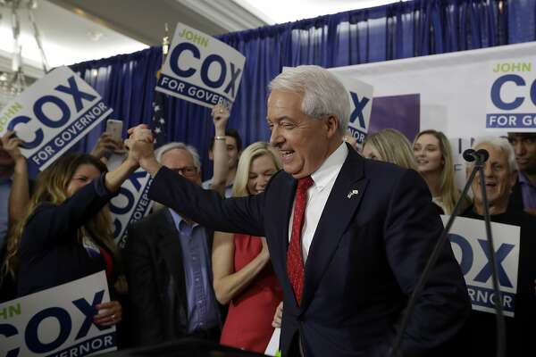 Republican gubernatorial candidate John Cox greets a supporter during a Republican election party Tuesday, June 5, 2018, in San Diego. (AP Photo/Gregory Bull)