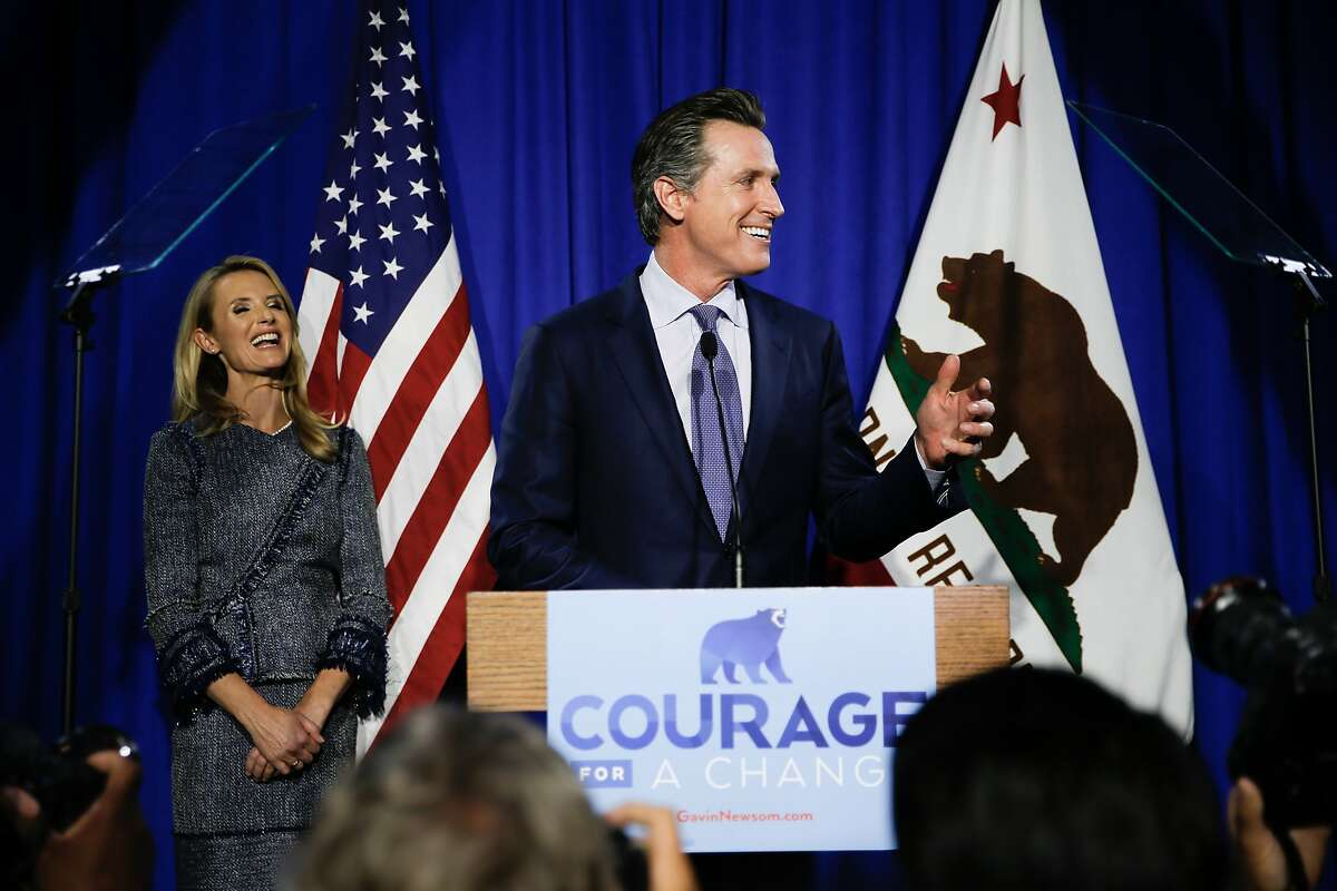 Gavin Newsom takes the stage with his wife Jennifer Siebel Newsom and speaks to his supporters during his election night party at Verso, Tuesday, June 5, 2018, in San Francisco, Calif. Newsom is running for Governor of California.