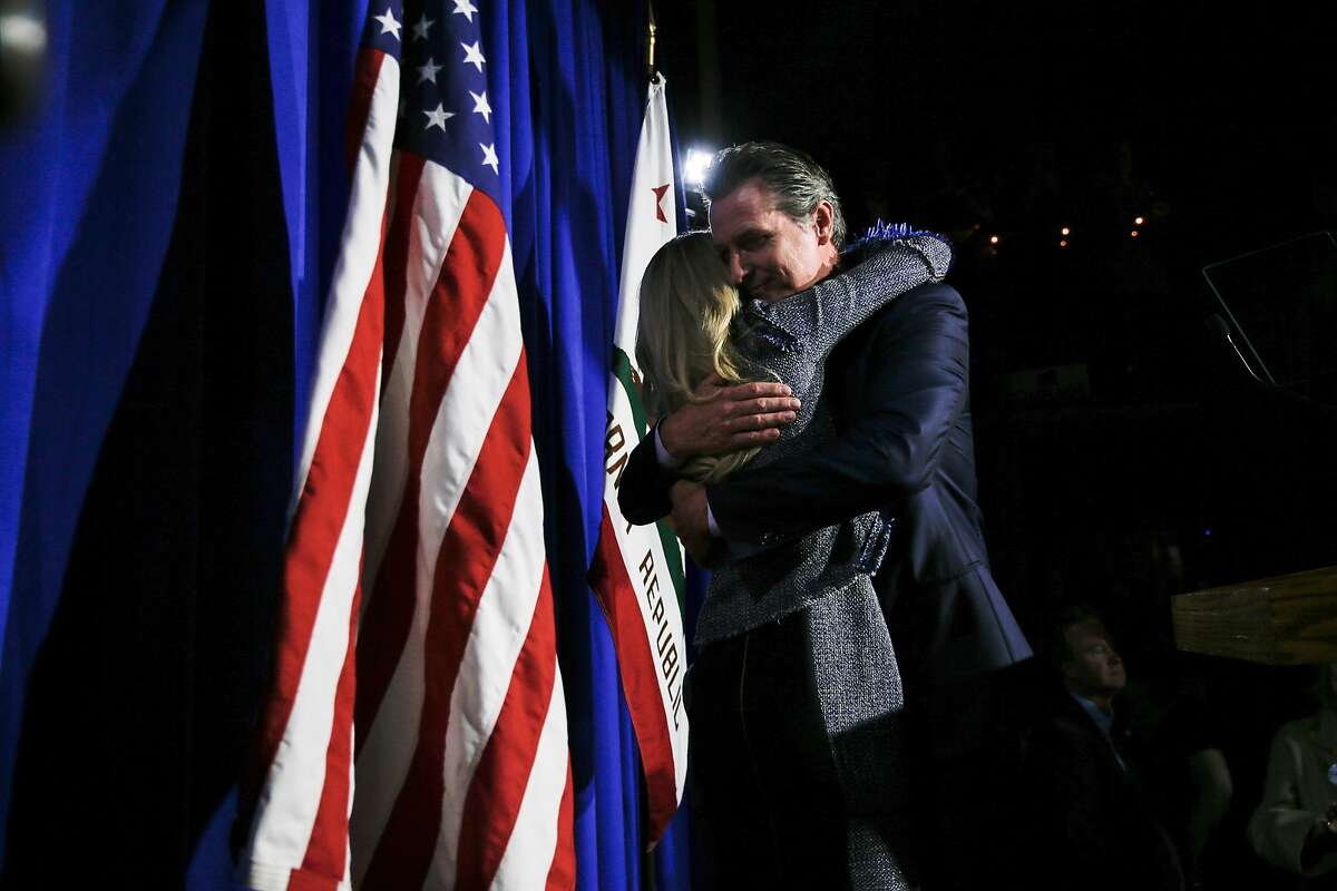 Gavin Newsom embraces his wife Jennifer Siebel Newsom after speaking to his supporters during his election night party at Verso, Tuesday, June 5, 2018, in San Francisco, Calif. Newsom is running for Governor of California.