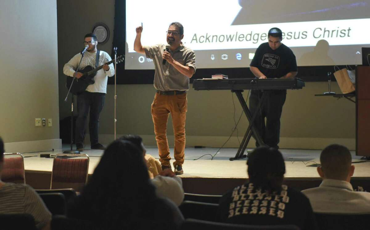 David Alvarado, director of the Repairer of Broken Walls Ministries, gives a testimony on being saved through prayer on Tuesday at the TAMIU Student Center Auditorium.