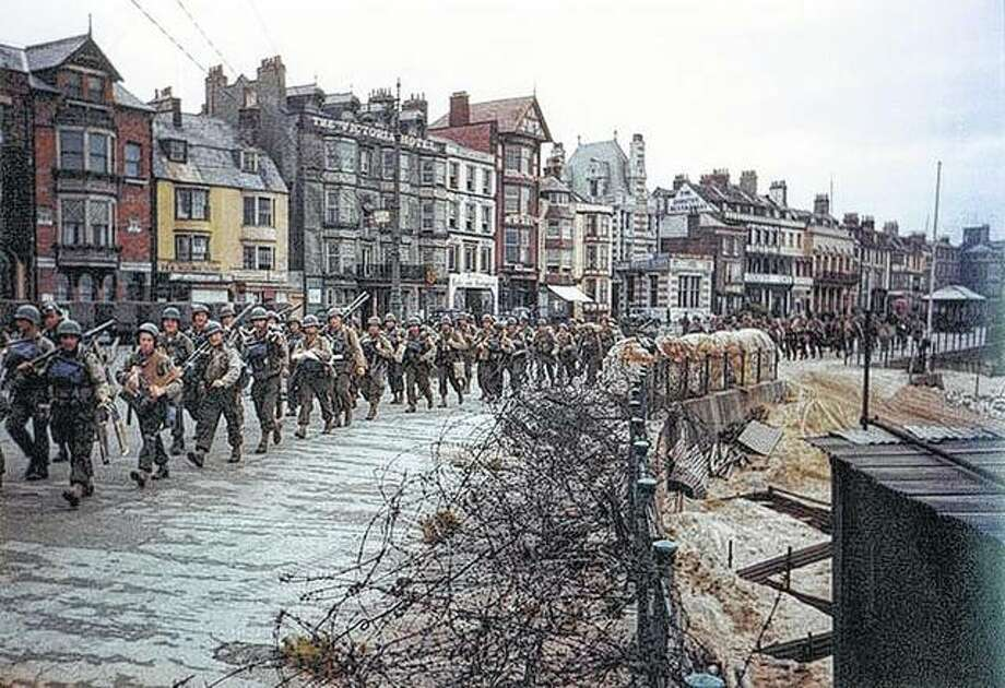 U.S. soldiers march en route to board landing ships for the invasion of France.