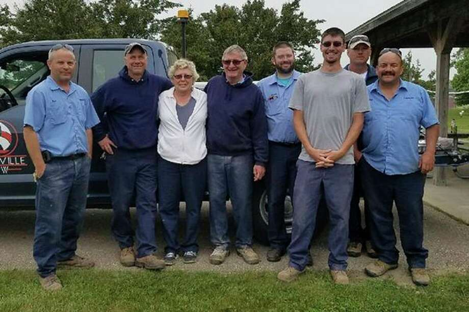 The City of Caseville recently recognized John Tait for his more than 30 years of service to the city. He ispictured with the city's DPW crew (from left): Rich Simpson, Troy Hartz, Patti Atwood, John Tait, James Guster, Matt Pryor, Karl Krull and Scott Kelly. (Submitted Photo)