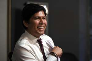 Kevin de Leon, California state Senate president pro tem and Democratic candidate for the U.S. Senate, laughs as he talks to his staff before speaking at an election party Tuesday, June 5, 2018, in Los Angeles. (AP Photo/Mark J. Terrill)
