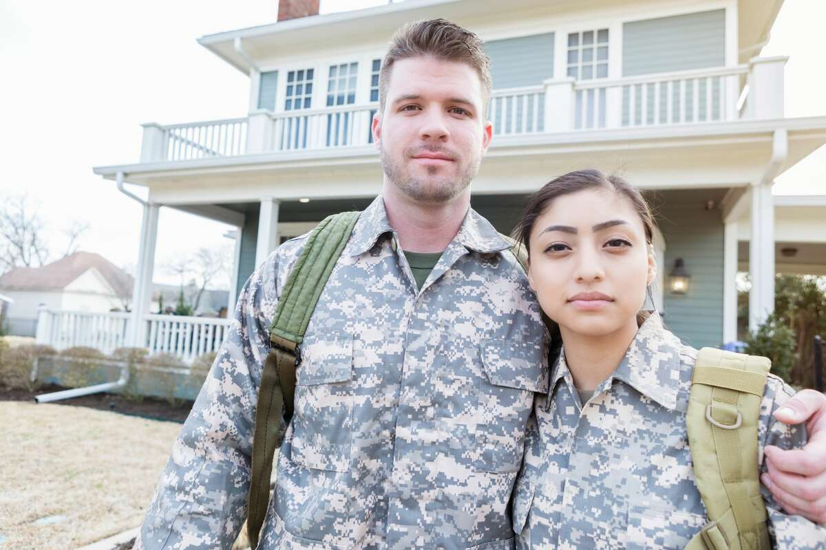 A military couple are often separate from each other.