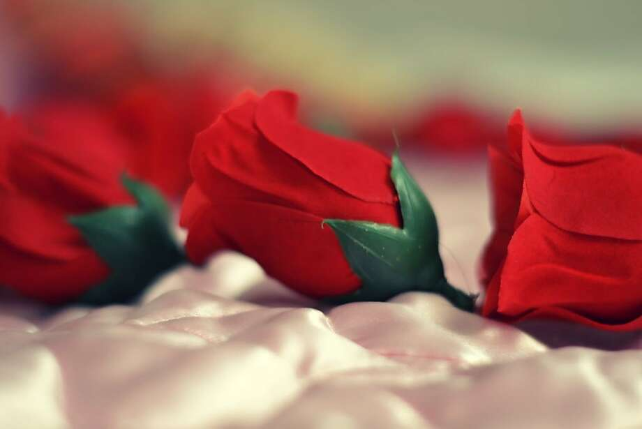 A family did not appreciate the gift a fake red rose. Photo: Fajrul Islam, Getty Images