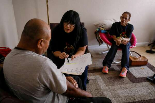 """Where is your daughter?"" principal Diana Del Pilar asks a student's father in his Gulfton apartment."