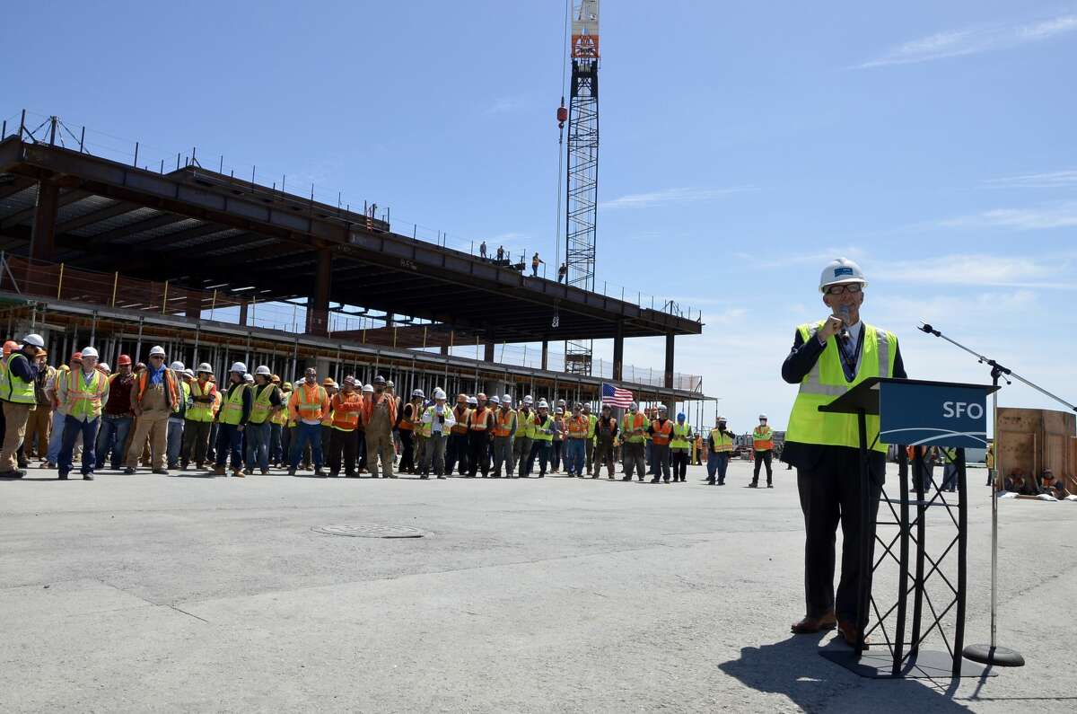 SFO Airport Director Ivar Satero welcomes a crowd at the topping off ceremony of the Terminal 1 project