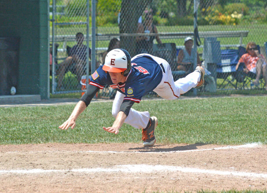Will Messer of the Edwardsville Post 199 Bears slides for the plate to score a run during the 2017 season. Messer will play for the Bears again this season.