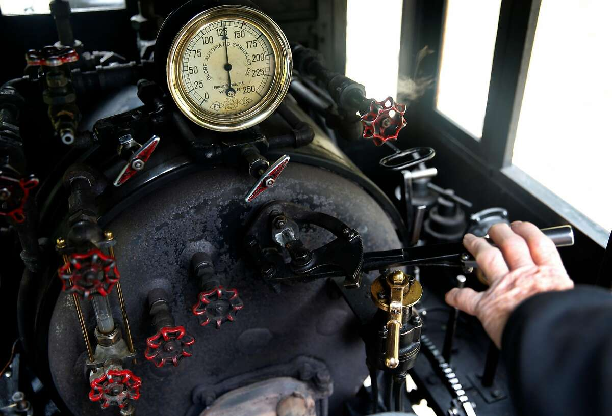 Ray Pimlott, chief engineer of the Redwood Valley Railway, operates the controls of the No. 5 �Fern� steam locomotive during a run on the 1.2-mile route at Tilden Park in Orinda, Calif. on Saturday, May 26, 2018.