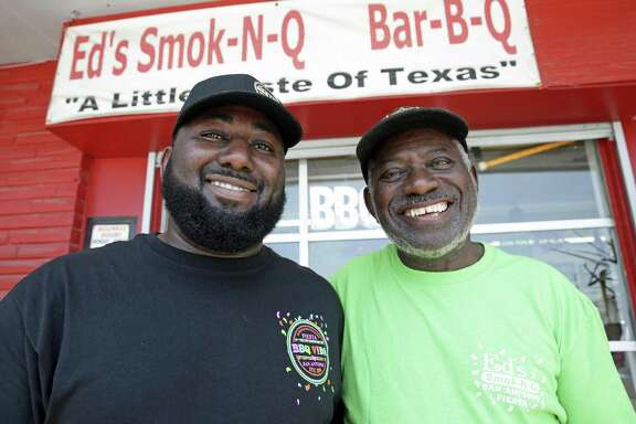 Chris Ashford stands with his father Ed Ashford in front of the elder's restaurant, Ed's Smoke-N-Q.