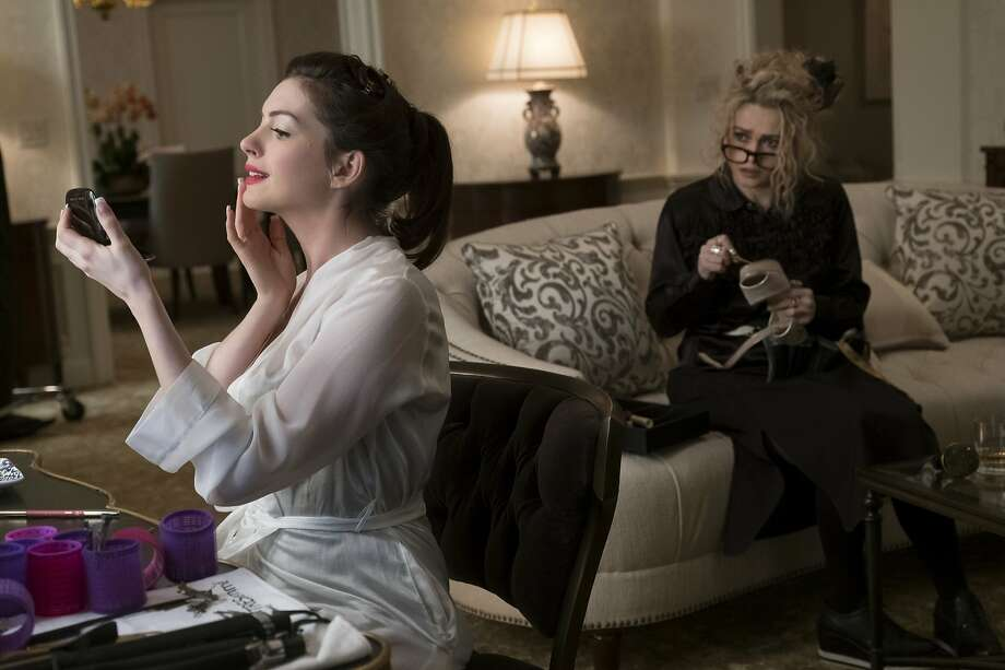 Anne Hathaway (left) as Daphne Kluger and Helena Bonham Carter as Rose Weil. Photo: Barry Wetcher / Warner Bros.