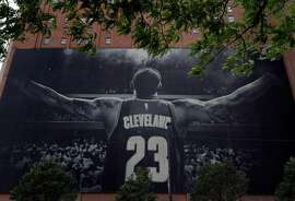 A 150-foot tall LeBron James banner hanging on the Sherwin Williams building near the Quicken Loans Arena the day before the Golden State Warriors play the Cleveland Cavaliers in Game 3 of the NBA Finals in Cleveland, Ohio, on Tuesday, June 5, 2018.