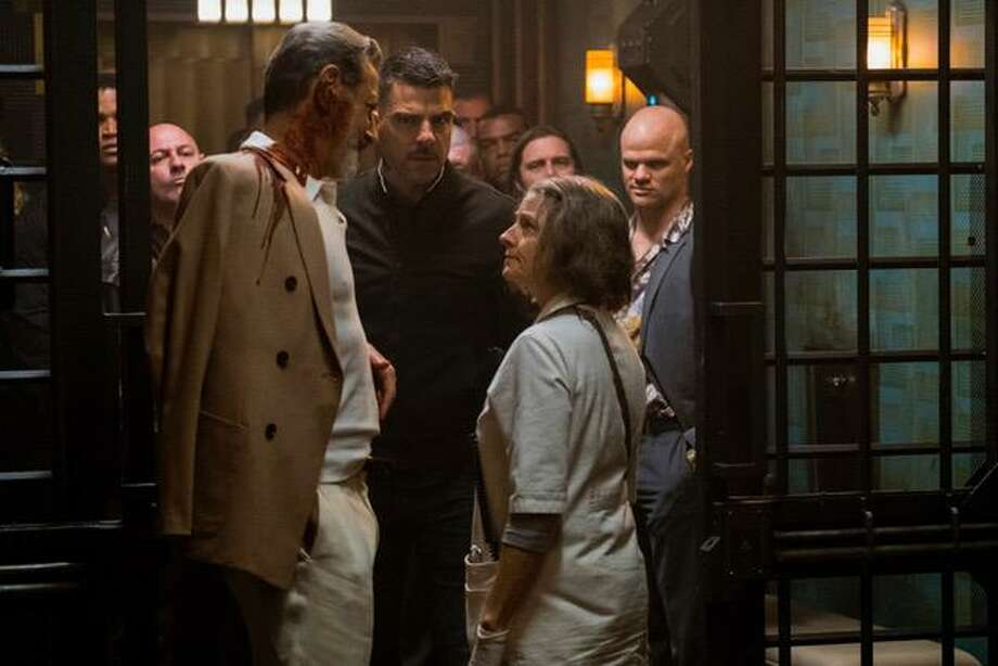 """Jeff Goldblum (left) and Zachary Quinto consult with Jodie Foster, playing a nurse who runs a hospital that specializes in discreetly treating injured criminals, in """"Hotel Artemis."""" Photo: Matt Kennedy / Global Road Entertainment / Online_yes"""