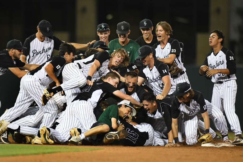 The Kingwood Park Panthers celebrate after their 5-3 win over Tomball Memorial in game 3 of their Region III-5A series at Blue Bell Park in College Station on June 2, 2018. Photo: Jerry Baker, Freelance / For The Chronicle / Freelance