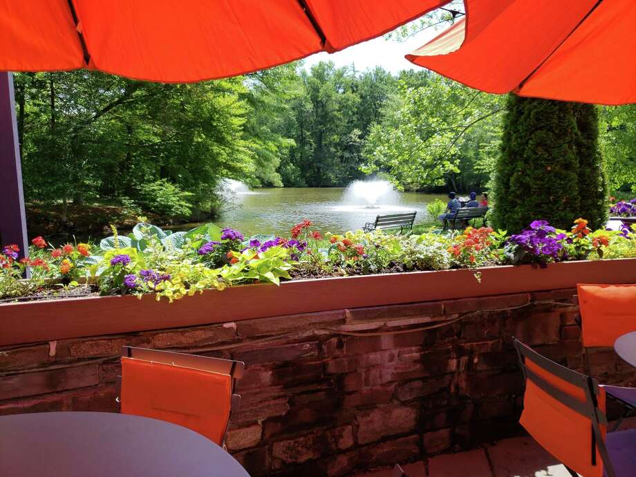 Patio dining overlooking the pond at The Pond House. Photo: Frank Whitman / For Hearst Connecticut Media / Norwalk Hour freelance