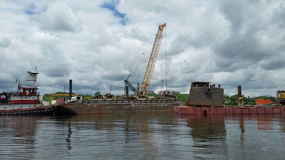 Crews lift up portions of a sunken barge from the bottom of the Hudson River at the Port of Coeymans on June 6, 2018. Photo: John Lipscomb/River Keeper