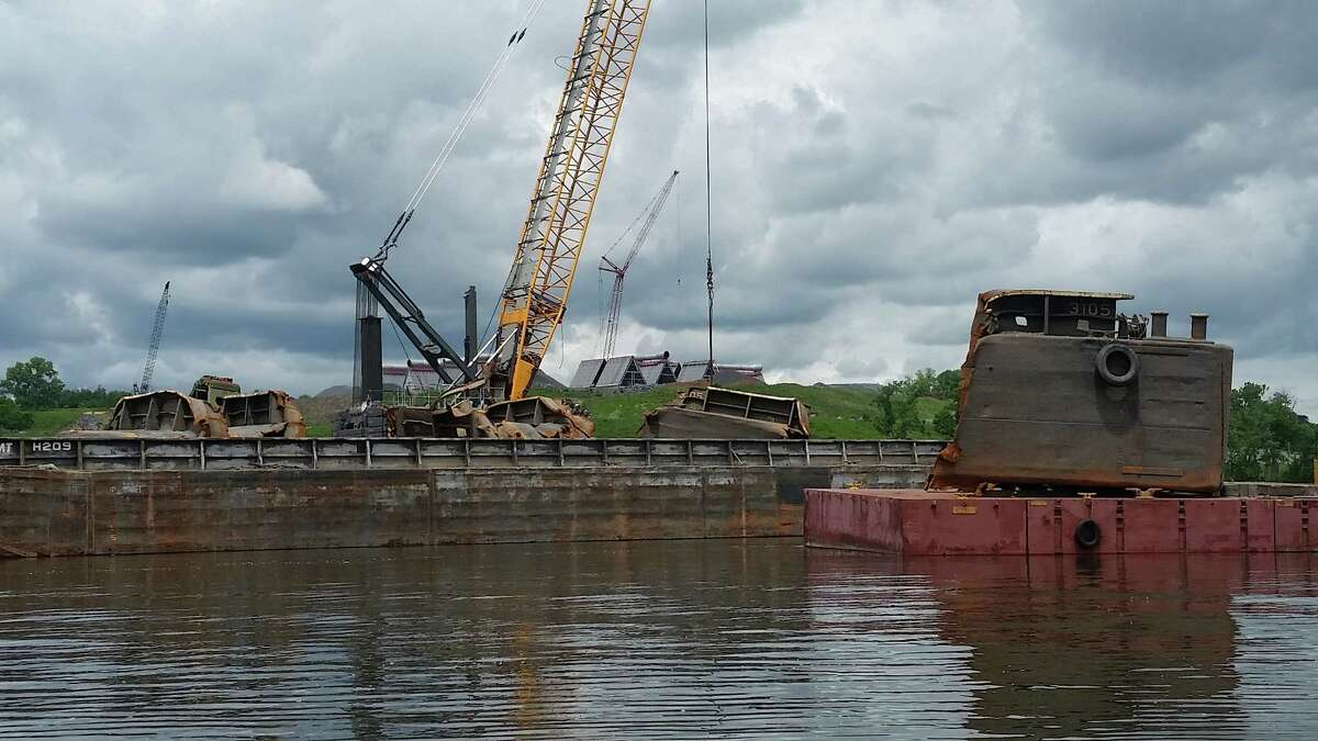 Crews lift up portions of a sunken barge from the bottom of the Hudson River at the Port of Coeymans on June 6, 2018. (John Lipscomb/River Keeper)