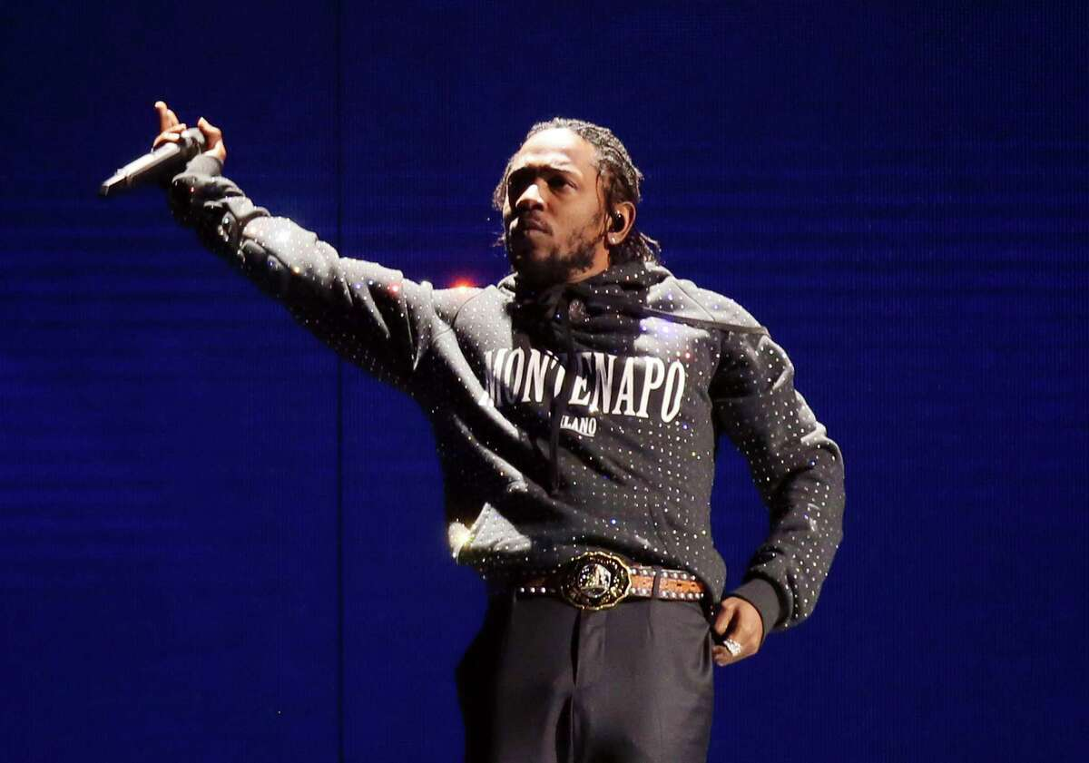 """FILE - In this Feb. 21, 2018 file photo, Kendrick Lamar performs at the Brit Awards 2018 in London. Lamar was nominated for five BET Awards including ones for best collaboration, with Rihanna for """"Loyalty,"""" video of the year, album of the year and Coca-Cola Viewersí Choice. (Photo by Joel C Ryan/Invision/AP, File)"""