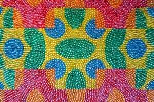 """A detail of """"Umbrella Carpet,"""" a previous work by the Dutch collective We Make Carpets, which will be in residence at Moody Center for the Arts beginning June 9 to create """"Crepe Paper Carpet,"""" inspired by papel picado constructions."""