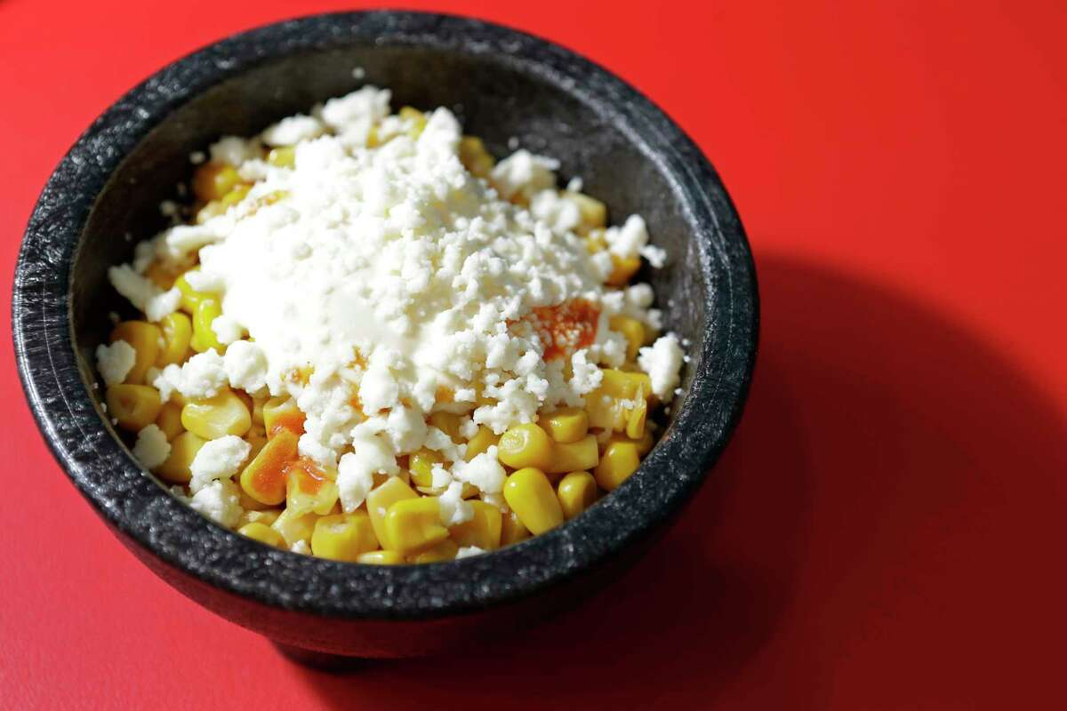 A dish of street corn flavored with mayonnaise, lime, chile and queso fresco at Dream Tacos TX.