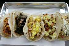 Chorizo, left, A.M. veggies, The Fairview, bacon baby, and Abuelita's breakfast tacos are shown at Dream Tacos, 3773 Richmond, Wednesday, June 6, 2018, in Houston.