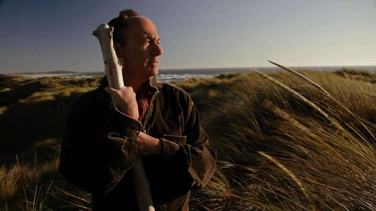 """Actor Mark Cohen as Prospero, performing a soliloquy from """"The Tempest"""" on a Northern California beach in a scene from Joshua Dylan Mellars' short film """"Shakespeare in the Shadows."""""""