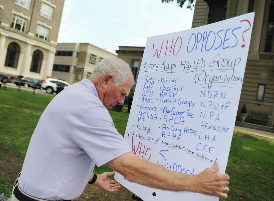 As a member of Indivisible Greenwich, Sandy Litvack, an posted a sign protesting the proposed American Health Care Act outside the Senior Center in downtown Greenwich. Litvack is now a Democratic selectman. Photo: Tyler Sizemore / Hearst Connecticut Media / Greenwich Time