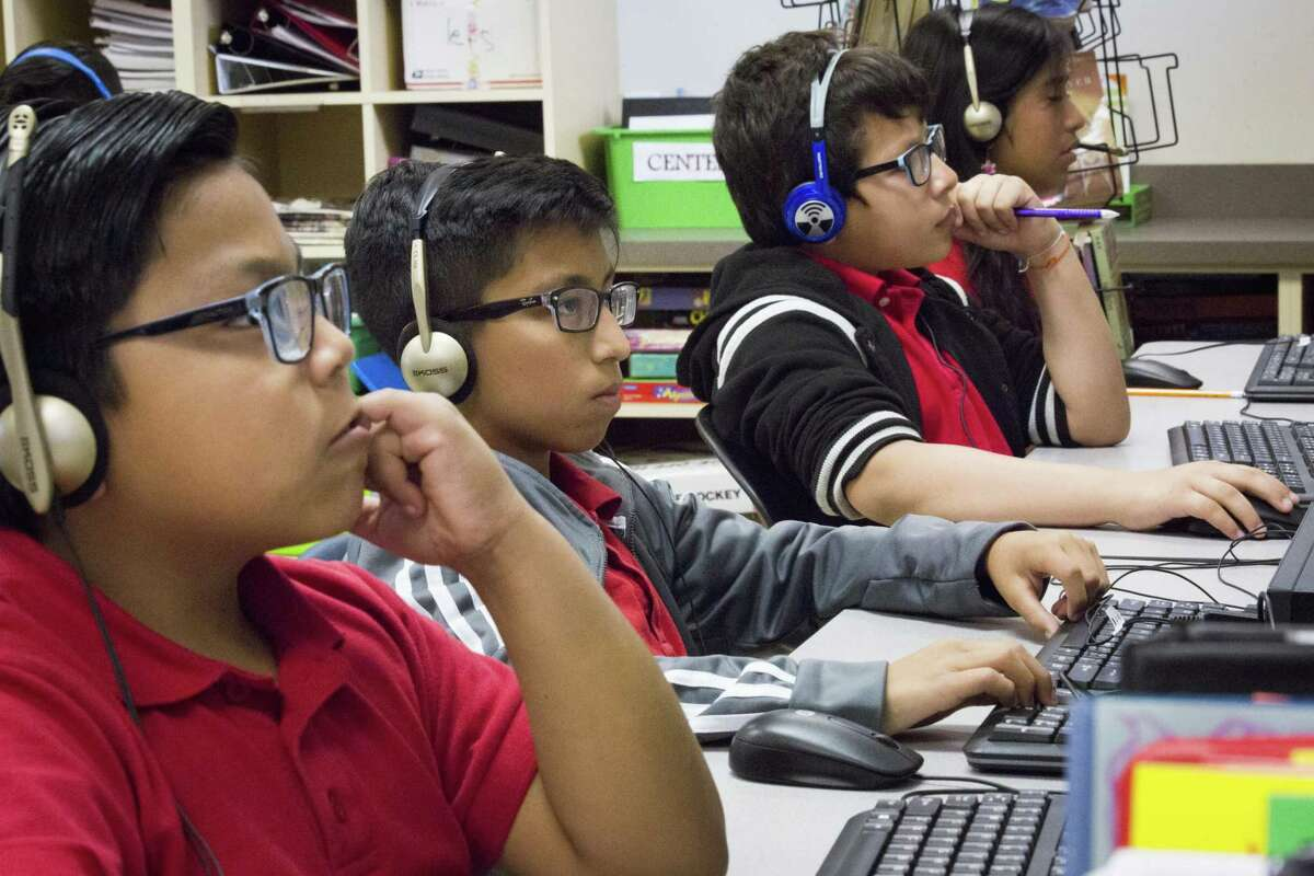 Pilgrim Academy fifth-grade students use the computer to work on their readings skills during class, Friday, May 11, 2018, in Houston.